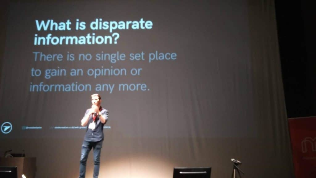Chris Marr on stage with a slide asking: What is disparate information?'