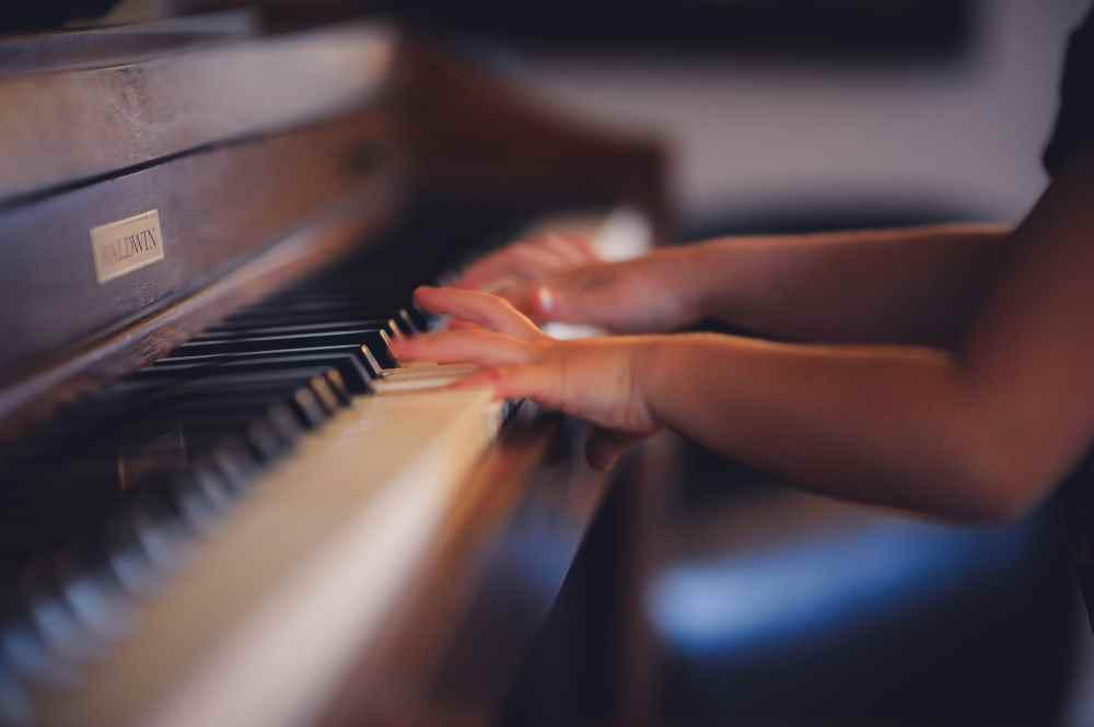 A photo of a young pianist. Photo by Clark Young on Unsplash