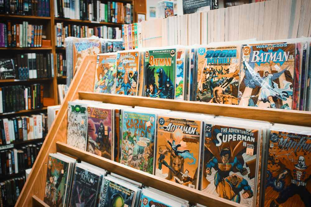 A photo of superhero comics in a bookstore by Lena Rose. Who did you want to be?