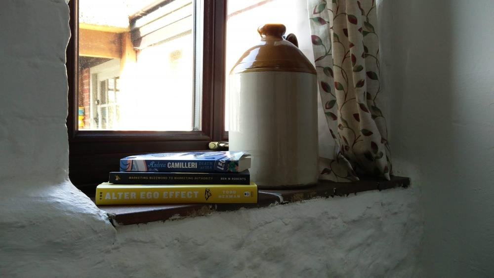 A photo of the 3 books I'm reading
