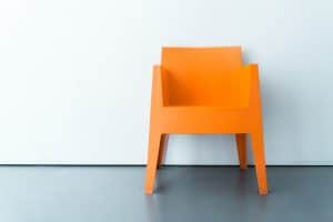 An orange chair. Photo by Rabie Madaci