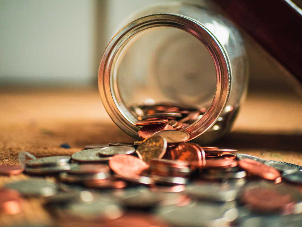 Cash spilling out of a jar. Photo by Josh Appel on Unsplash