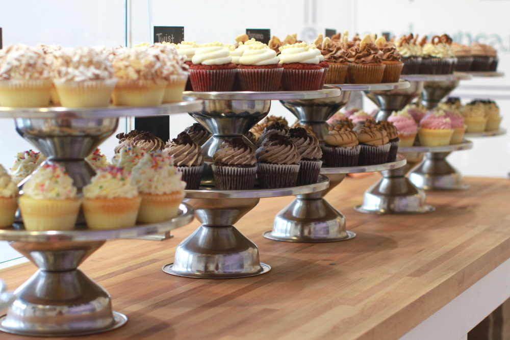 A photo of a counter full of cupcakes by Meghan Rodgers