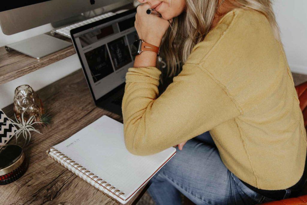 A woman working. Photo by Corinne Kutz on Unsplash