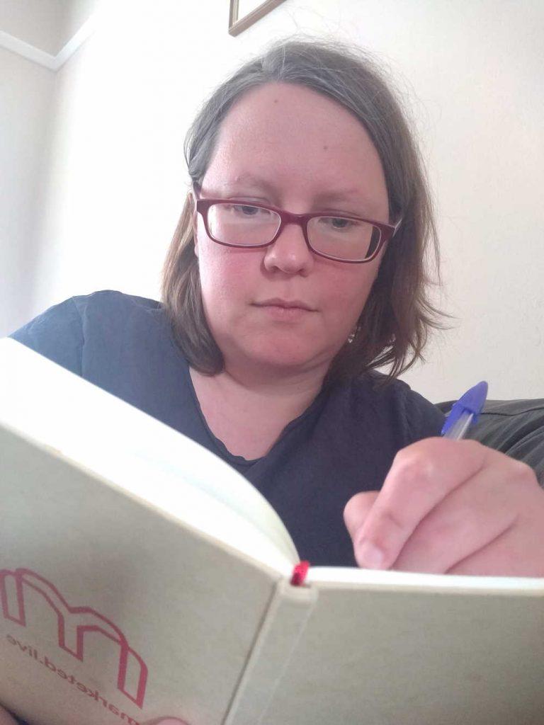 Rachel writing in her planner