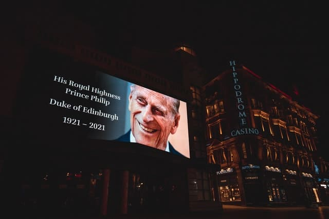A billboard commemorating Prince Philip. Photo by Frankie Lu on Unsplash