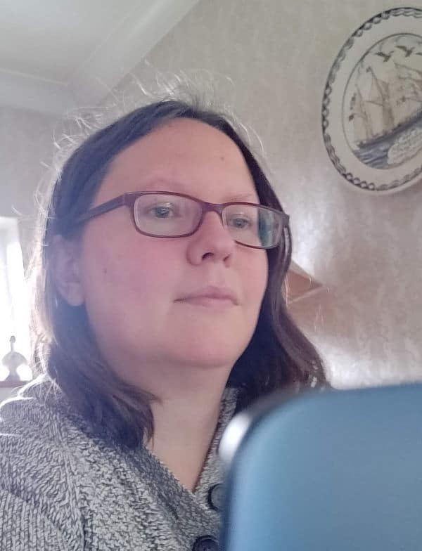 Photo of Rachel working at laptop